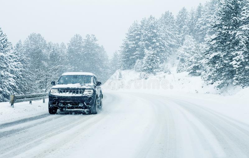 Traffic car on winter road in snow blizzard. Traffic car vehicles on winter road in snow blizzard stock photography