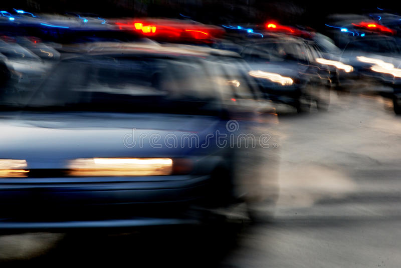 Traffic of cars on the night road. The headlights stock photo