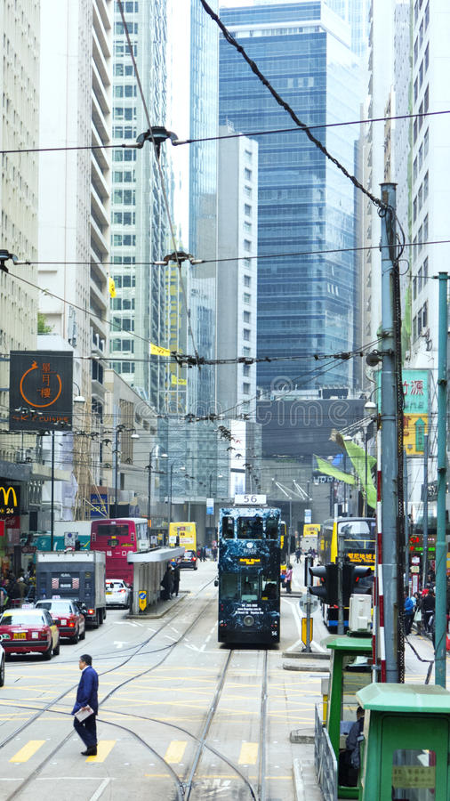 Traffic and city life in this Asian international business and financial center. HONG KONG - JANUARY 14,2016: In the Streets of Hong Kong.Traffic and city life stock photo