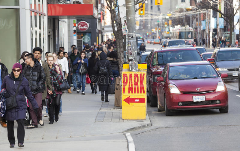 Traffic in the city of Toronto and citizens, Canada. Park sign. Traffic in the city of Toronto, Canada. Different machines in a row. Sidewalks with many royalty free stock images