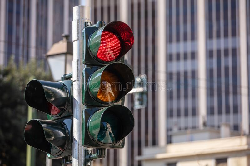 Traffic concept downtown. Red traffic lights for cars, office buildings. Background stock image