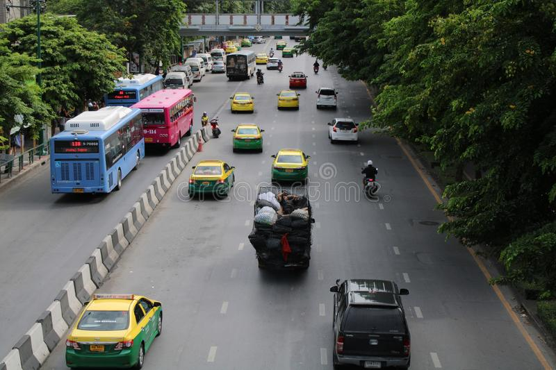 Traffic conditions on the road in Bangkok, Thailand. Taxi, transportation, travel, industry, business, transit, car, motorbike, motorcycle, way, street stock photos