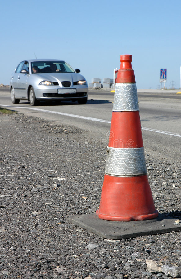 Download Traffic Cone On Road With Car Stock Image - Image: 1414505