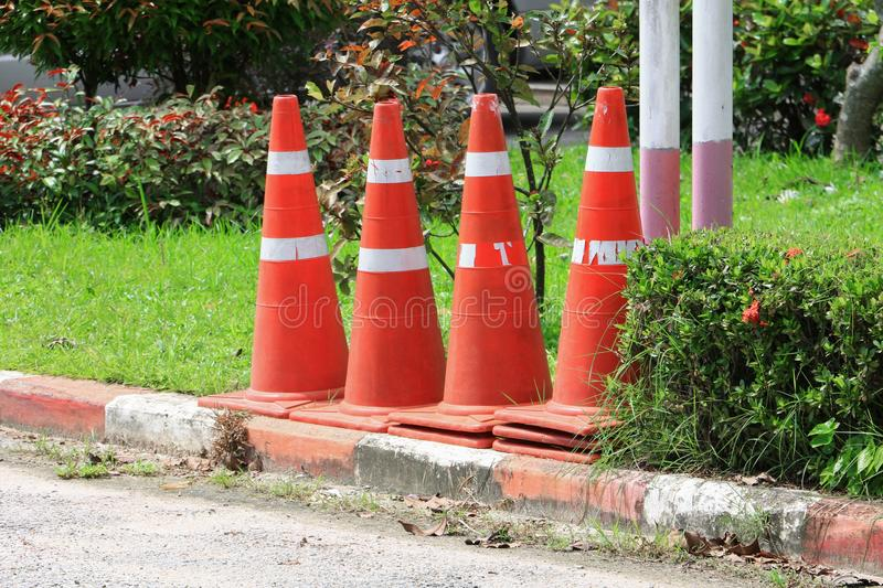 Traffic cone row white and orange stripes set are roadside with copy space royalty free stock photography