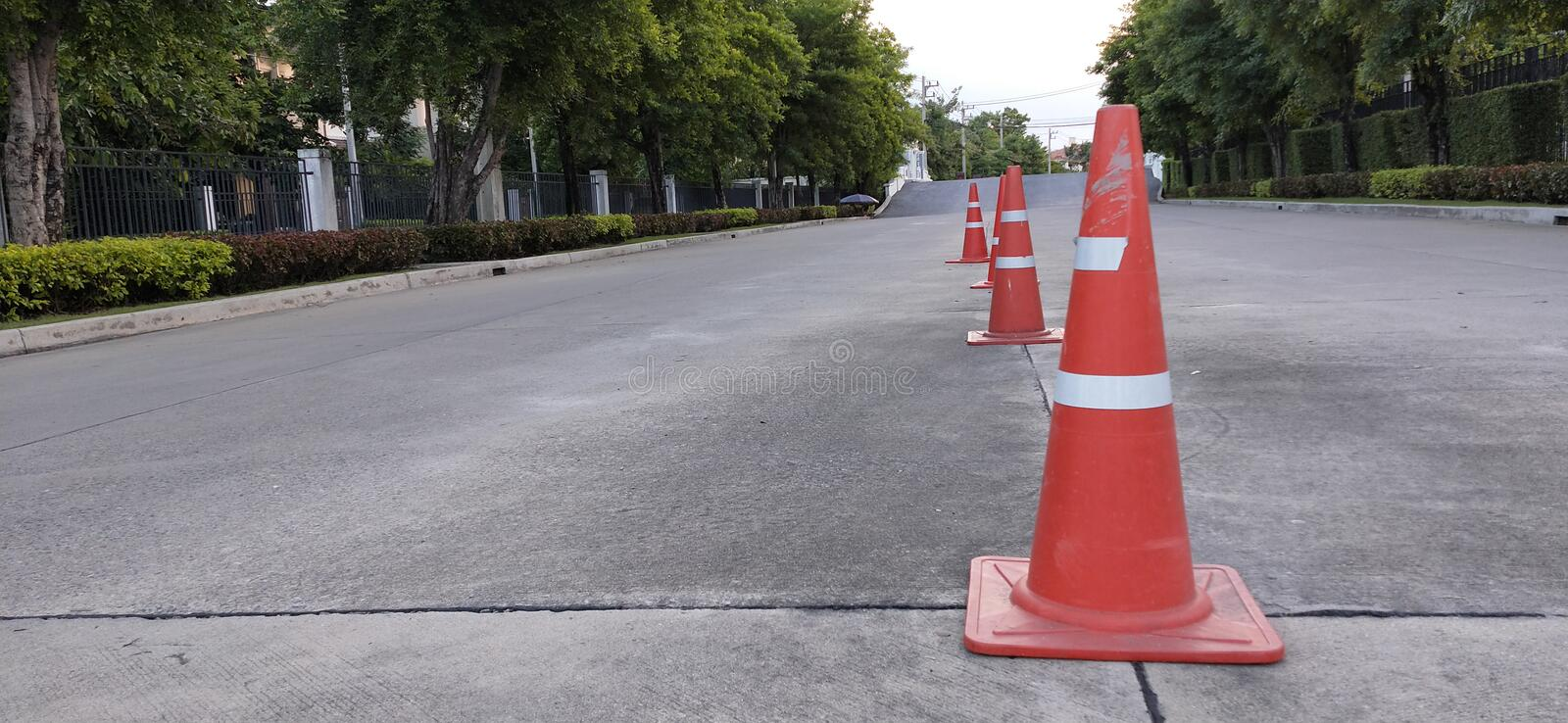 traffic cone on village road royalty free stock photos