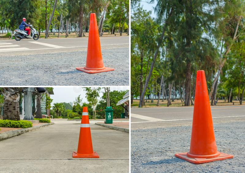 Traffic cone, with white and orange stripes stock photography