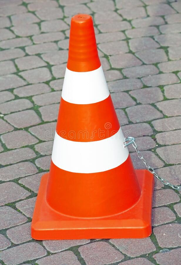 Traffic cone with white and orange stripes stock images