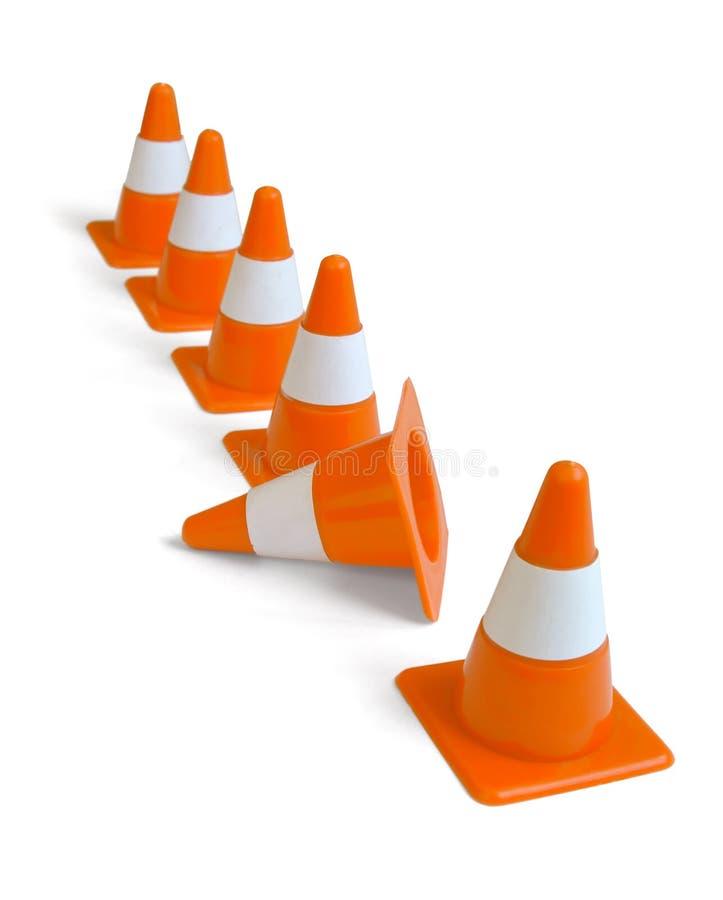 Traffic cones. Row of orange plastic traffic cones isolated on white royalty free stock photo