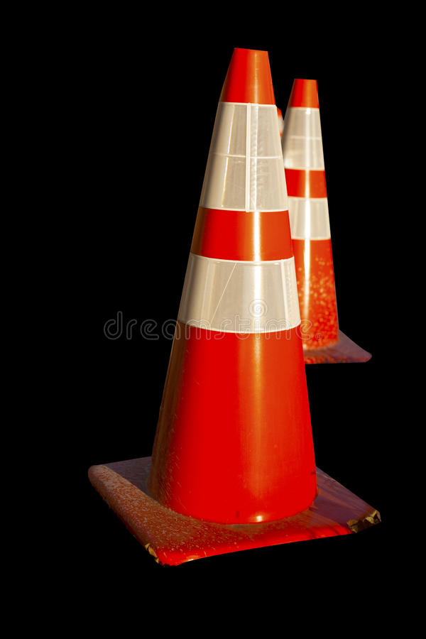 Traffic cones. On a black background royalty free stock photo