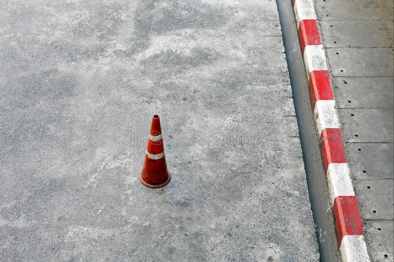 Traffic cones, Cement ground floor and plastic traffic cones red and white stripes is Safety equipment on the road stock photos