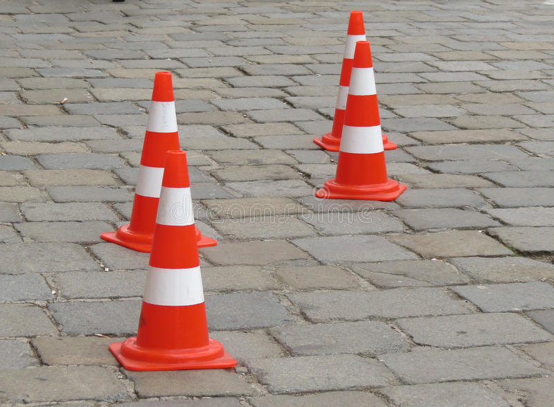 Traffic cones on the street. Traffic cones aka construction cones, witch's hat, pylons, road cones, highway cones, safety cones royalty free stock photography