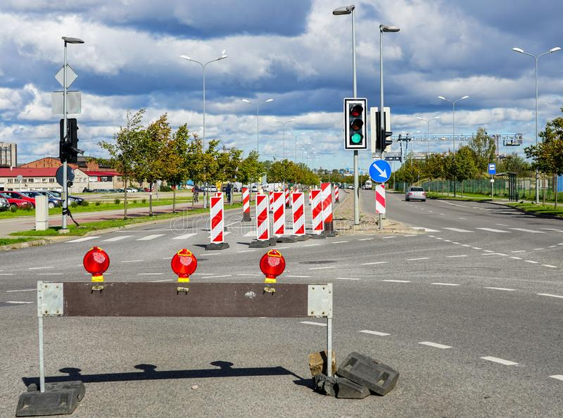 Traffic constraints during street repairs, warning signs. Traffic constraints during street repairs in city, warning signs stock images