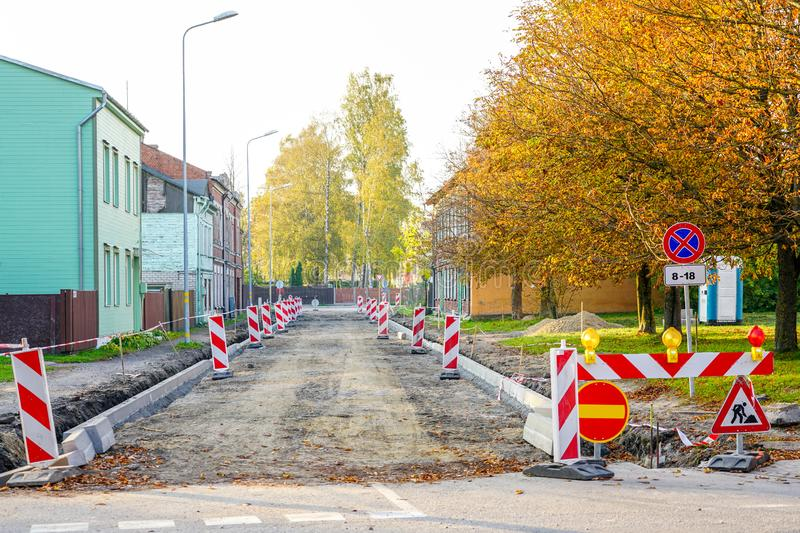 Traffic constraints during street repairs, warning signs. Traffic constraints during street repairs in city, warning signs royalty free stock photos