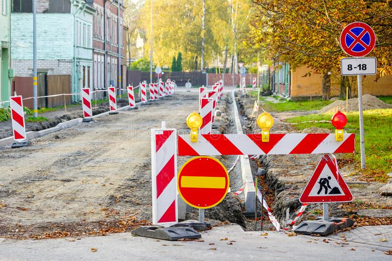 Traffic constraints during street repairs, warning signs. Traffic constraints during street repairs in city, warning signs royalty free stock image