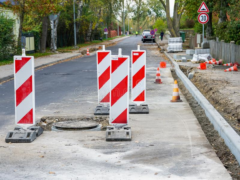 Traffic constraints during street repairs, warning signs. Traffic constraints during street repairs in city, warning signs royalty free stock images