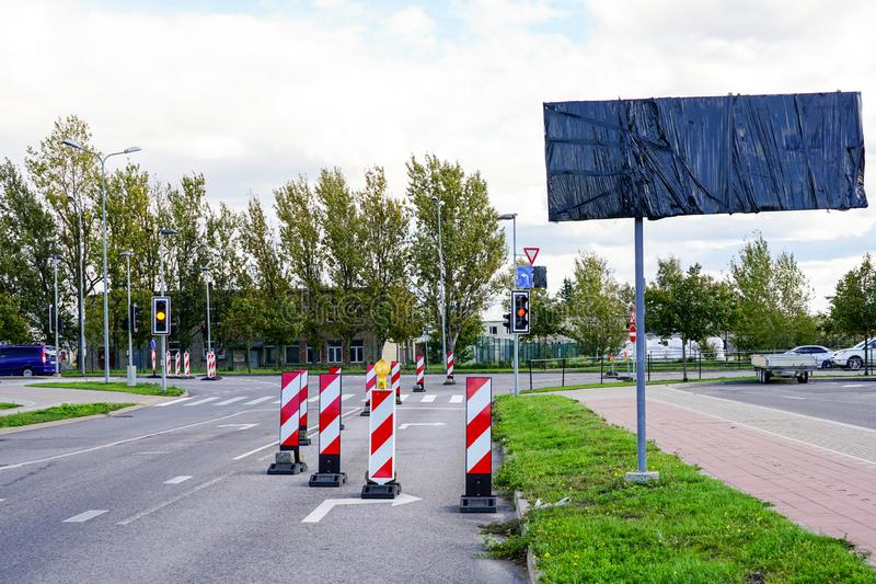 Traffic constraints during street repairs, warning signs. Traffic constraints during street repairs in city, warning signs stock image