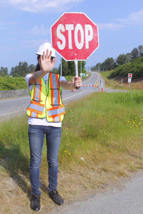 Traffic Controller Stopping Traffic stock image