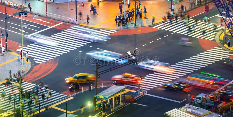 Traffic crosses an ntersection in Shibuya, Tokyo, Japan. Traffic crosses a busy intersection in Shibuya, Tokyo, Japan stock image