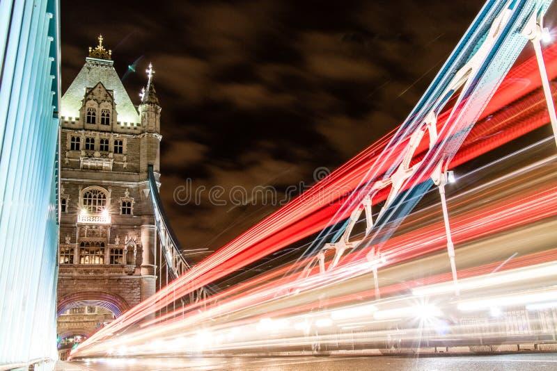 Traffic Crossing Tower Bridge. Traffic whizzing across Tower Bridge in London, the UK stock photography