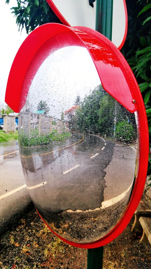 A traffic curve mirror stock photography