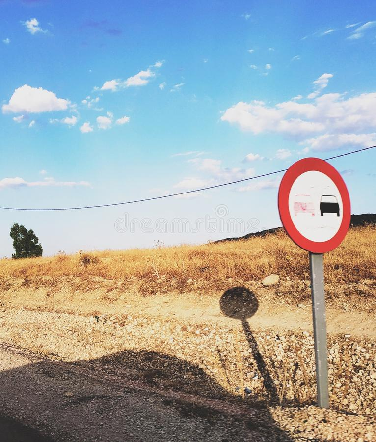 Traffic signes no overtaking Panel in the country side of algeria. Traffic Direction Panel no overtaking in the country side of algeria in the summer royalty free stock image