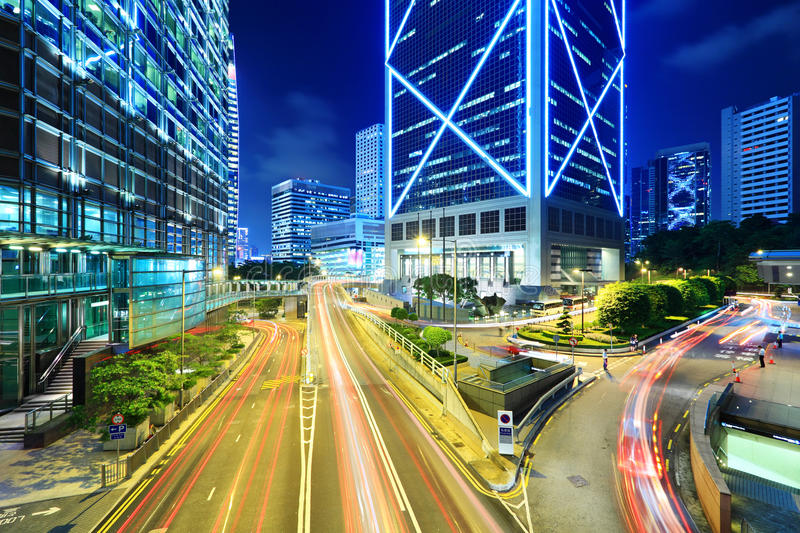 Traffic through downtown. Traffic in modern city at night royalty free stock photography