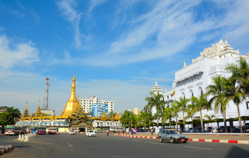 Traffic in downtown Yangon, Myanmar. YANGON, MYANMAR - JAN 15, 2015. Traffic in downtown Yangon, Myanmar. In the middle of a roundabout, Yangon City Hall is royalty free stock photography