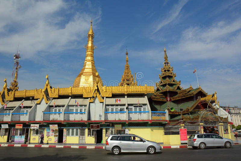Traffic in downtown Yangon, Myanmar. YANGON, MYANMAR - JAN 15, 2015. People and vehicles in downtown Yangon, Myanmar. In the middle of a roundabout, Yangon City stock image