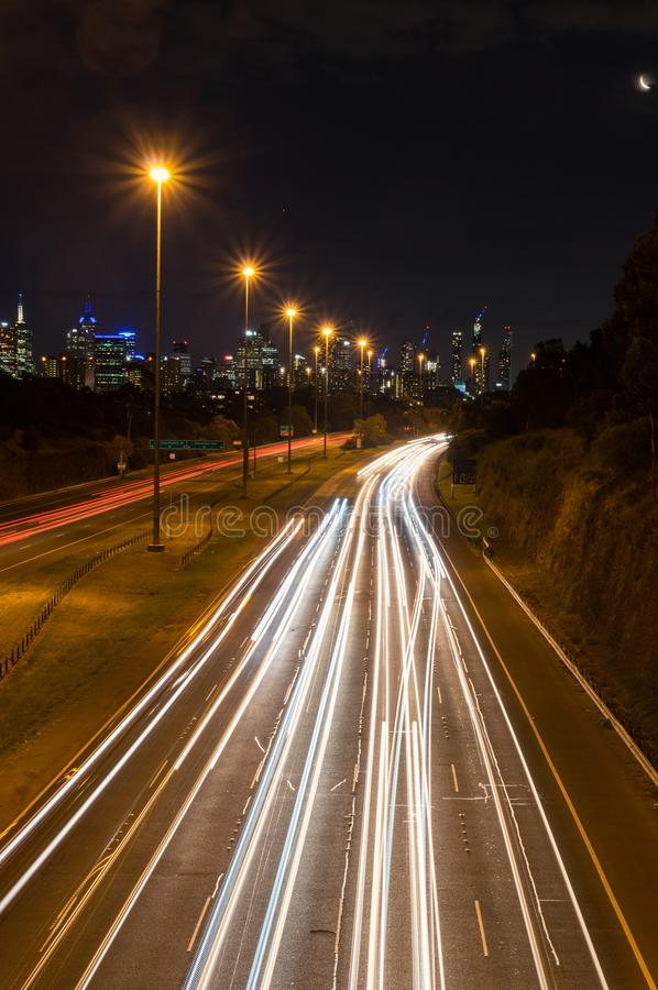 Traffic on the Eastern Freeway in Melbourne, Australia. Traffic on the Eastern Freeway at dusk, passing through Yarra Bend Park, as seen from the Yarra Bend Road stock photo