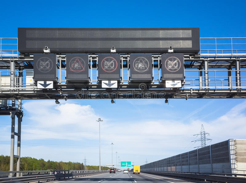 Traffic enforcement cameras over traffic lanes stock photo