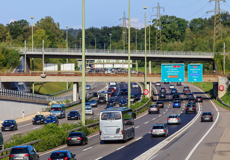 Traffic on a European motorway. Wallisellen, Switzerland - 3 September, 2017: traffic on the E 41 and E 60 motorways. E 41 is a European route with its ends in stock photos