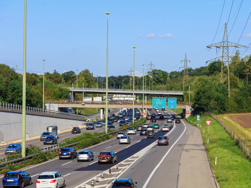 Traffic on a European motorway. Wallisellen, Switzerland - 3 September, 2017: traffic on the E 41 and E 60 motorways. E 41 is a European route with its ends in royalty free stock photography