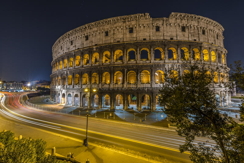 Traffic In Front Of Colosseum In Rome Stock Photo