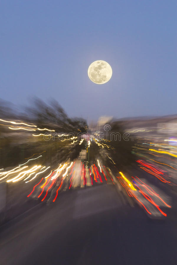 Traffic and full moon royalty free stock photo