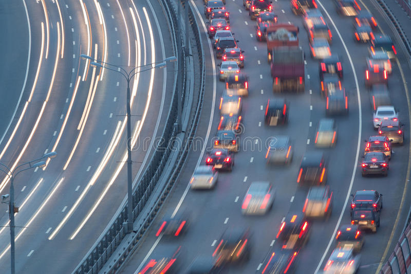 Traffic on highway. With motion cars stock images
