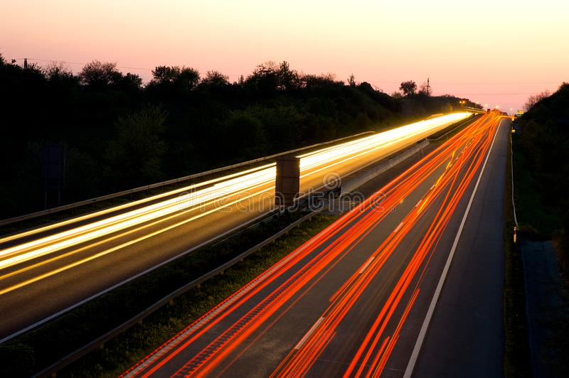 Traffic On A Highway At Night Free Stock Photo