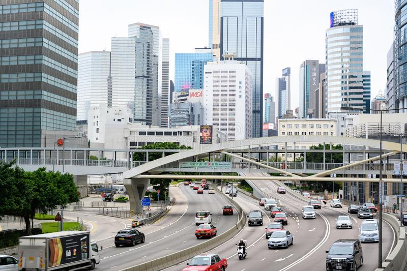 Traffic in Hong Kong Island with footbridge for pedestrians royalty free stock photos