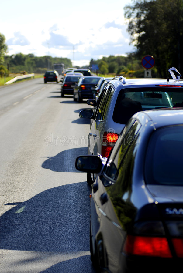 Traffic jam. Cars sitting in traffic jam; view of brake lights and back of cars stock photos