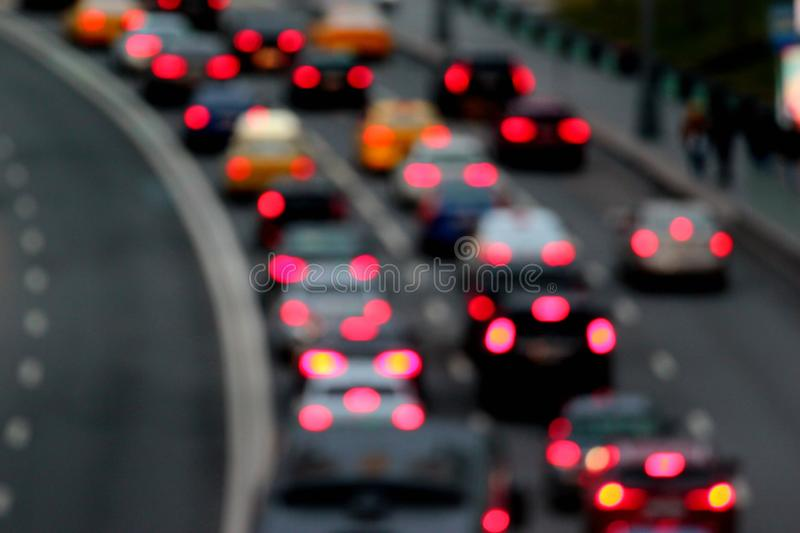 Traffic jam at dusk. Abstract blurred cars with red lights at night.  royalty free stock photos