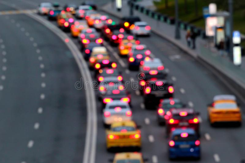 Traffic jam at dusk. Abstract blurred cars with red lights at night.  stock photo