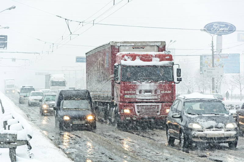 Traffic jam formed at the road caused by a heavy snowstorm. KIEV, UKRAINE - FEB 06: Snow storm created traffic collapse on february 06 2015 in Kiev, Ukraine stock photography