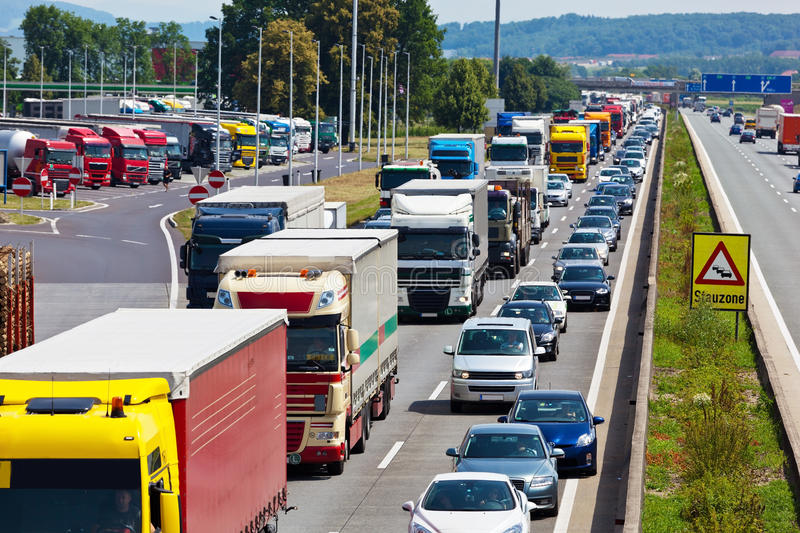 Traffic jam on highway. Non-functional emergency lane in a traffic jam on a highway stock image