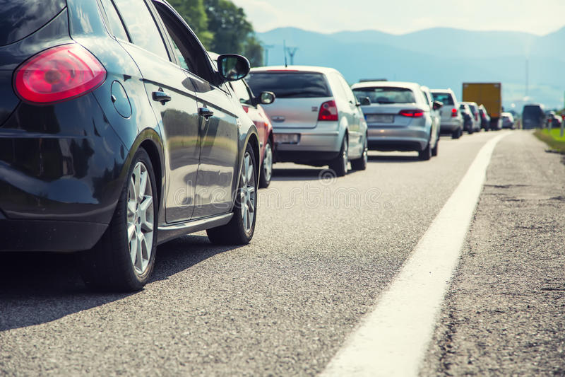 Traffic jam on the highway in the summer holiday period or in a. Traffic accident. Slow or bad traffic stock photography