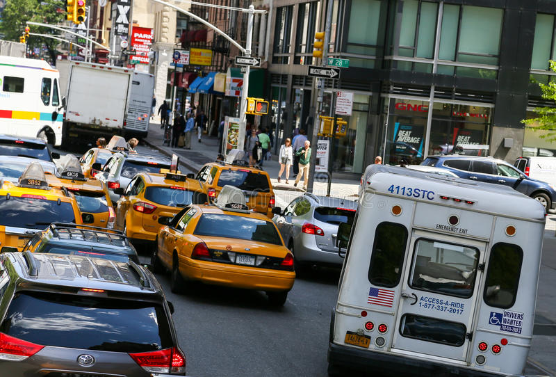Traffic jam in New York. New York City, USA - May 19, 2014: Many cars in the streets of manhattan, waiting at traffic lights royalty free stock photos