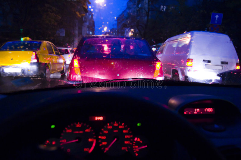 Traffic jam at night. A view of a traffic jam looking out of the front windshield of a car at night stock photos