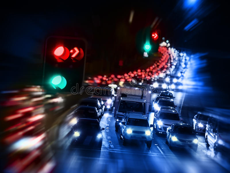 Traffic Jam pollution. Pollution problem caused by traffic jam at night with blur and zoom affect stock photo