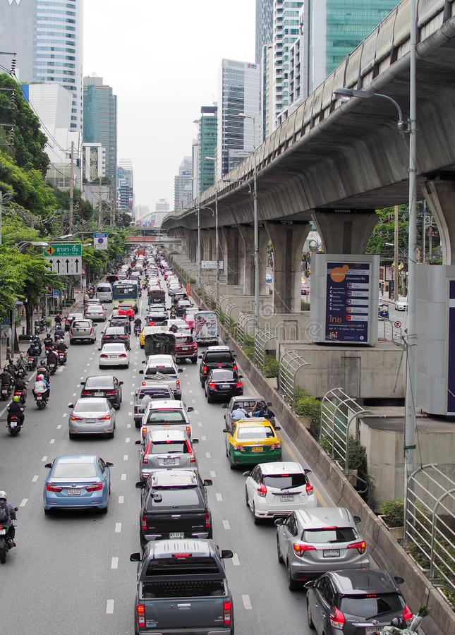 The traffic jam with smoke and pollution Haze on Sathorn road. The main roads of Bangkok. stock photo
