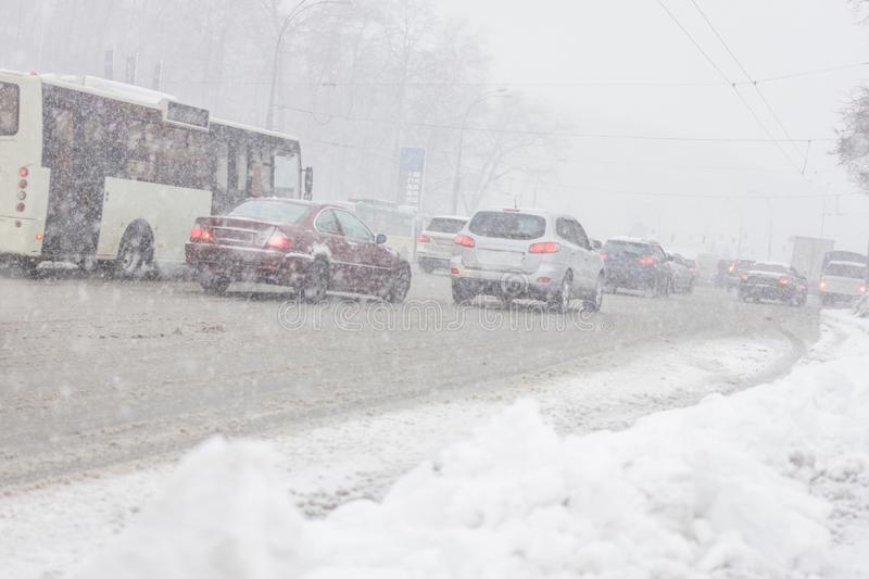 Traffic jam in snowstorm, Kiev. Winter snow road with many cars royalty free stock images