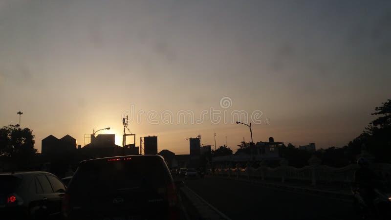 Traffic jam and sunset royalty free stock image