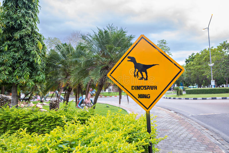Traffic label with dinosaur pictogram stock photography